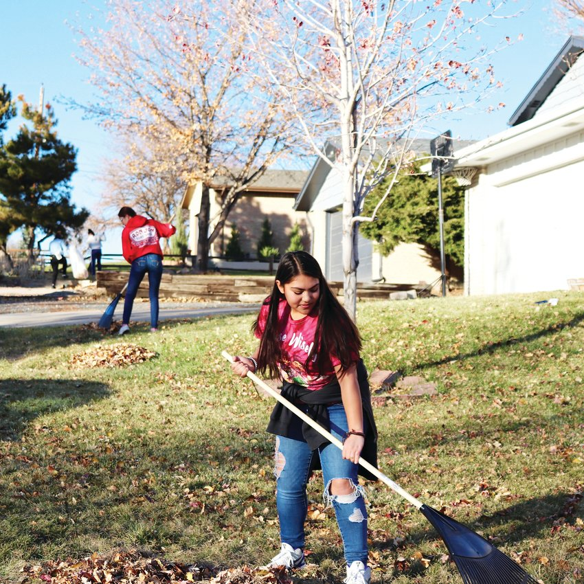 Student Jayla Rodriguez and her teammates from the Arvada High girls' basketball team split up across the neighborhood during their volunteer work, which the team undertakes when the weather permits.