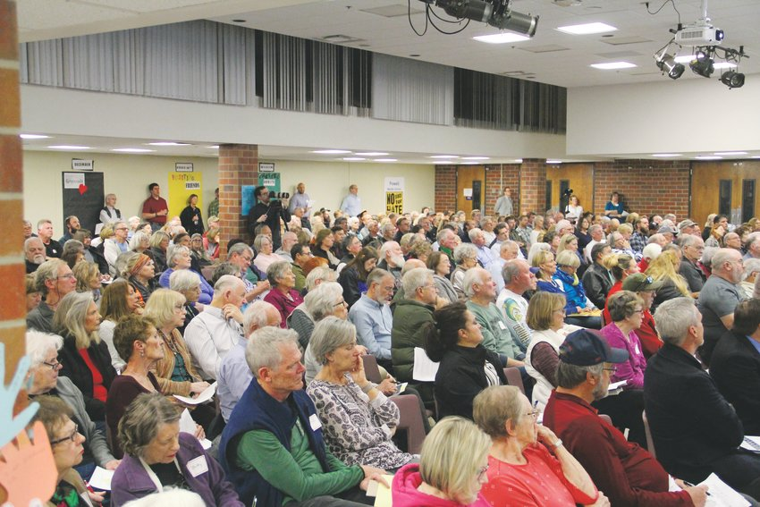 Hundreds filled a meeting about redevelopment at The Streets at SouthGlenn Nov. 19 at Powell Middle School.