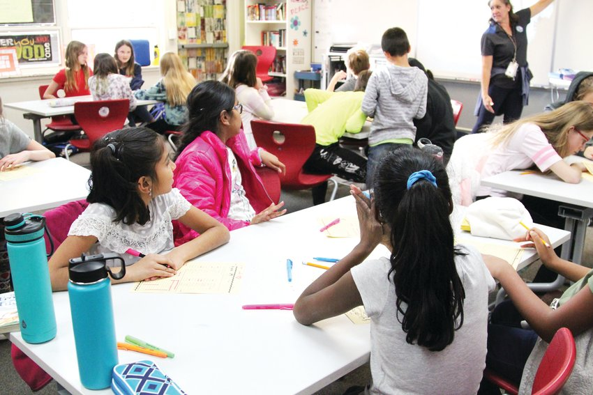 Students listen to Irma Margione in a Spanish class at Northridge Elementary School.