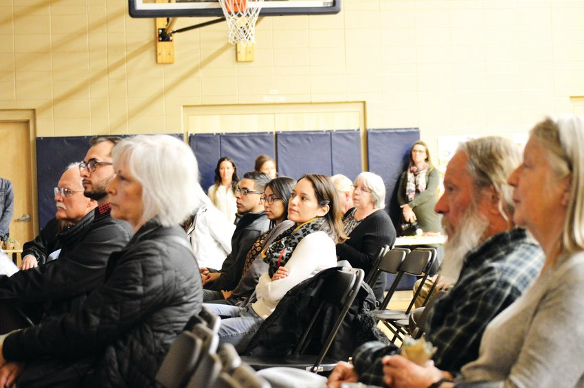 Residents and neighbors of a proposed Uplands mixed-use development listen to developers during an open house at Crown Pointe Academy Nov. 13. The project would replace the farmland north of Westminster's Pillar Fire Church with homes, parks and small businesses.