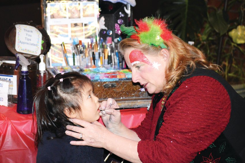 Make-up artist Kelleen Raska paints Lisa Mung, 4, part of the city's 2018 Noel Northglenn Festival. It returns Dec. 6 this year