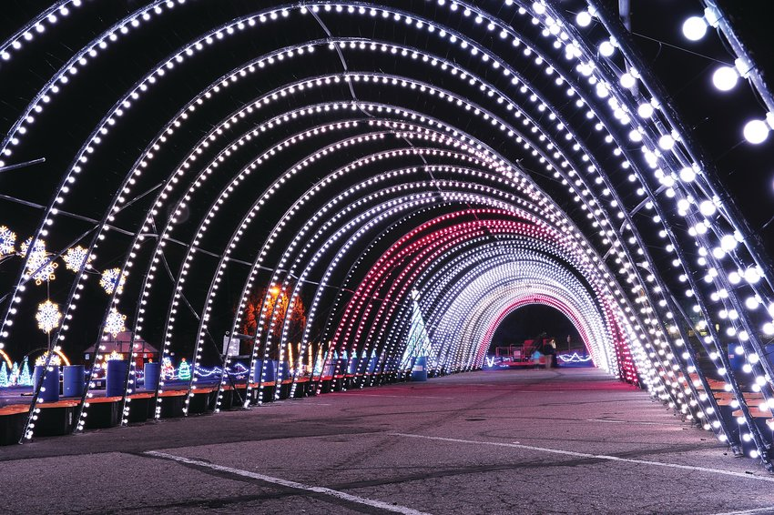 "A long archway of Christmas lights gets tested at Water World in Federal Heights. The lights are part of the facility's ""Christmas In Color"" display, which was set to begin Nov. 22  and run through Jan. 4. Tickets are $27 per car."