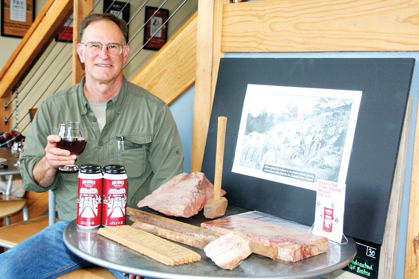 Ken Balleweg, a geological engineer who owns a home in Golden and Beulah, enjoys a Beulah Red Ale on Nov. 14 at Holidaily Brewing Company. Balleweg spoke with Holidaily guests about Beulah marble and its significance to the Colorado Capitol Building in downtown Denver.