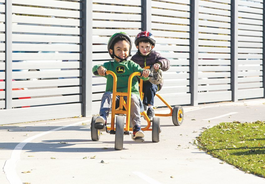 Children ride around bikes at the Maddox Early Childhood Education Center. The school has 232 children, and between 60 to 70 of its students have special education needs.