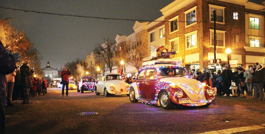 VW Bugs decorated in Christmas lights participated in the parade through Historic Downtown Littleton. The cars, along with the Heritage Highschool Brass, the Littleton Youth Ballet and more, led Santa to the stage where he lit up a giant tree with Christmas lights.