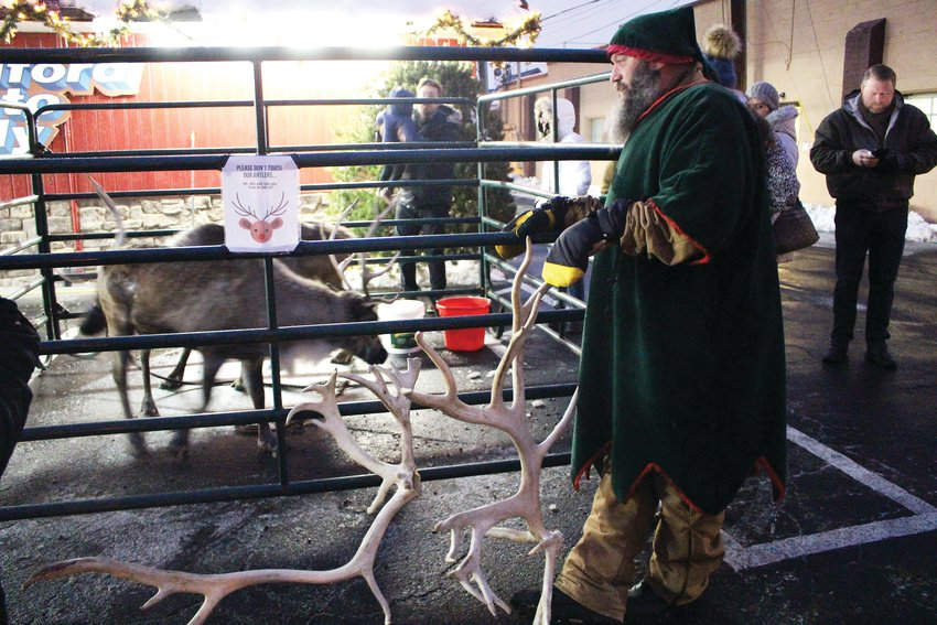 Families were able to visit live reindeer at Bradford Auto Body during the 36th annual Candlelight Walk. The reindeer was one of many holiday attractions for families to interact with along Main Street.