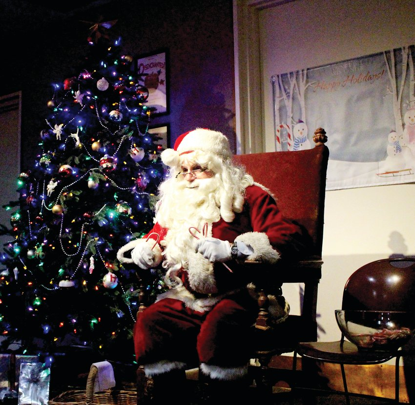 Santa sat to visit with children at the Town Hall Arts Center after the parade and tree lighting. Families lined up to take photos of their kids sitting with Santa.