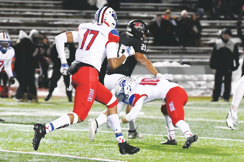 Cherry Creek's defense played a key role in the Bruins' 14-7 semifinal victory over Pomona on Nov. 30 at the Stutler Bowl. Senior safety Chavis Nourse (10), who had a fumble recovery early in the game, prepares to make a tackle on Pomona's Sanjay Strickland (25) as the Bruins' Dolonte Dickey (17) follows the action.