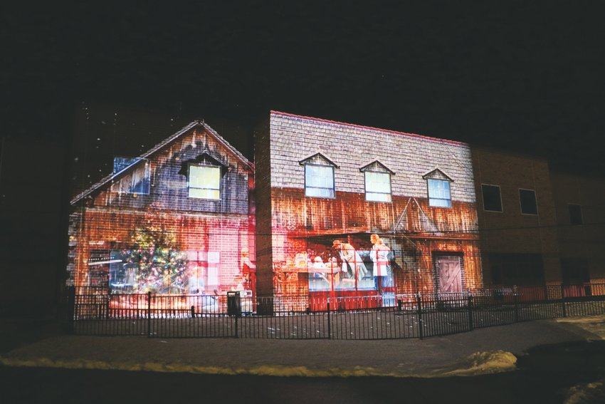 The Cherry Hills Community Church Christmas light show tells the story of a family's holiday traditions. In some spots, scenes are projected onto the side of the church.