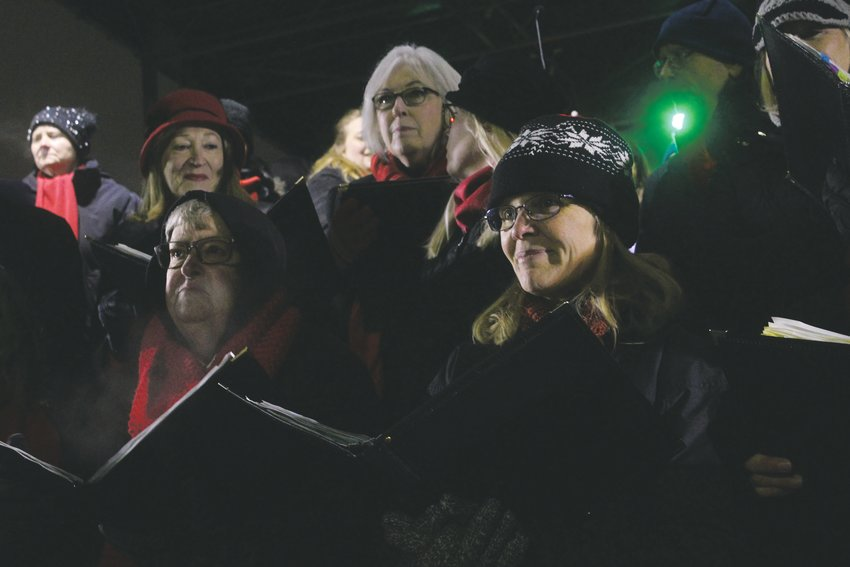 Members of the Parker Chorale prepare to lead the crowd in Silent Night to kick off the festivities to the Mayor's Holiday Lighting Nov. 28.