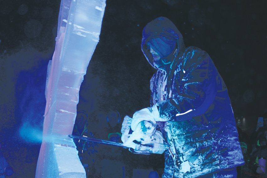 An ice sculptor demonstrates the process of chiseling away ice at the Mayor's Holiday Lighting event in downtown Parker Nov. 28.