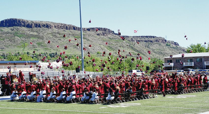 Golden High School's Class of 2019 throw their caps in the air in celebration during its graduation ceremony on May 24 at Marv Kay Stadium on the Colorado School of Mines campus.