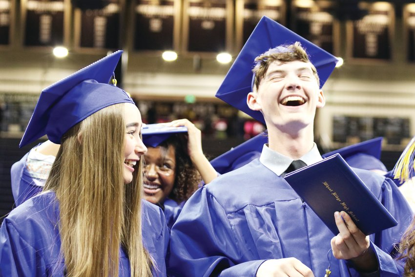 Wheat Ridge High School seniors celebrate after moving their tassels to commemorate their 2019 high school graduation.