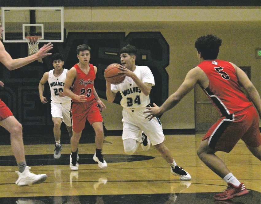 Upcoming Wolves' senior Manuel Madera drives through the paint last year against Brighton.