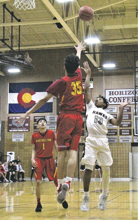 Horizon soon-to-be sophomore Xavier Harris attempts the floater last year against Northglenn.