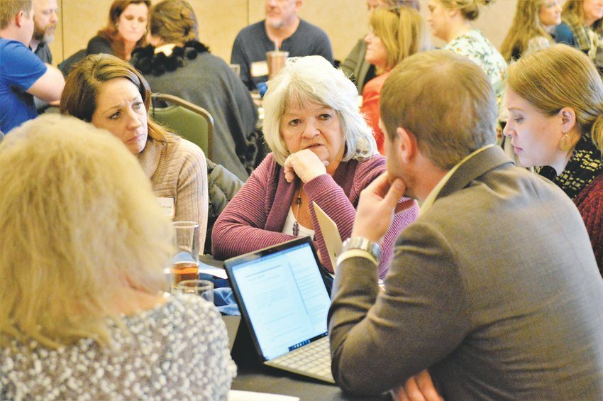 Westminster's Rosie Garner listens as one of her table-mates makes a point during a forum on access to mental services Nov. 22 at Cianco's Restaurant at Hyland Hills Golf Course. The forum was sponsored by Community Reach Center.