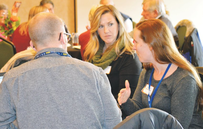 Residents discuss what they view as pitfalls and barriers that keep people from seeking mental health treatment during a Nov. 22 forum sponsored by the Community Reach Center.