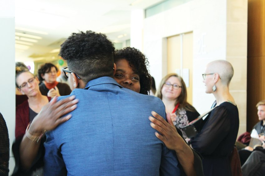 Karen Wilson hugs Jassir before his adoption was finalized at Denver Adoption Day. Wilson was Jassir's mentor while he was in the foster care system with Denver Human Services.
