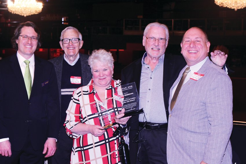 Andy Baldyga, left, stands with winners of the Characters of Colfax awards for 2019: members of the Feher-Peiker family, and Dave Walstom, second from the right. The Colfax Ave Business Improvement District gives out the awards annually.