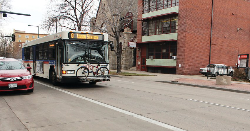 Buses on Lincoln Avenue drive in the regular traffic lanes during the day before moving over to the far right for bus stops. Denver staff are proposing to either extend the bus hours of the far right lane, or make it a 24-hour designated bus lane.