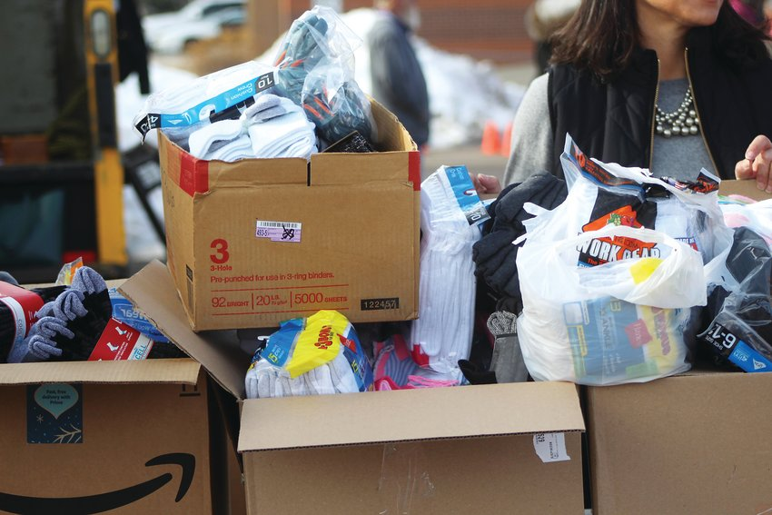 Some of the socks The Action Center was able to collect. With each pair of socks, The Action Center asked residents to donate a dollar that will go toward the reopening of its overnight shelter. The shelter will house six to 12 Red Rocks Community College students who are experiencing homelessness.