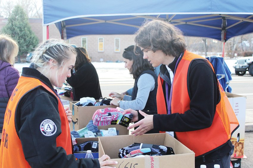 Matthew Steckly and Siri Christopherson count socks at The Action Center on Dec. 4. The two are volunteers for AmeriCorps, a program that works to strengthen communities through volunteering.