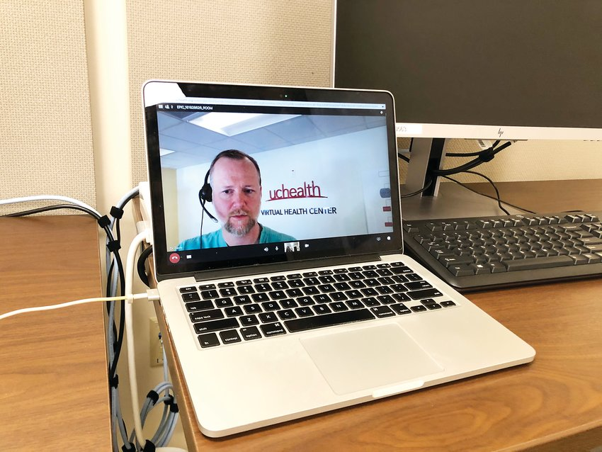 Dr. Christopher Davis, the medical director of UCHealth's virtual health center, appears in a video feed during a virtual urgent care appointment. Patients can use these visits for things like the flu, a cold, a UTI or pink eye.