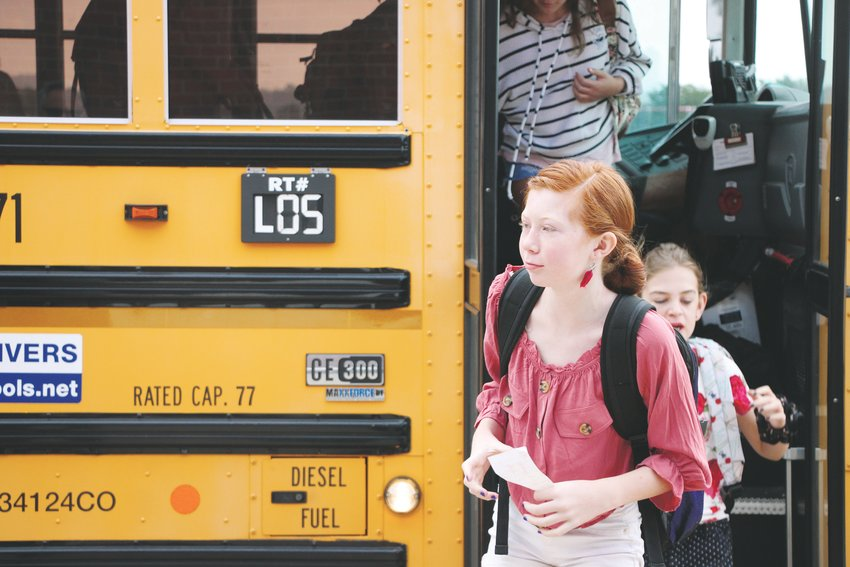Denver Metro Area students disembark a bus during the first day of school of the 2019-2020 school year.