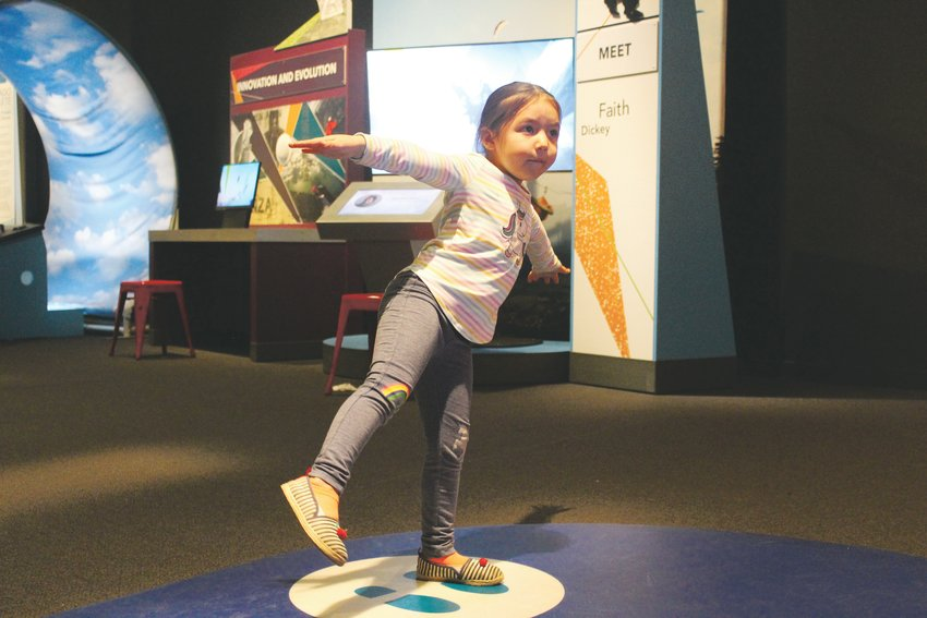 Mia Rios tests her kinesthetic sense at the exhibit. The temporary exhibit comes from Science North, a museum in Ontario, Canada. It's on display until April 12 of next year at the Denver Museum of Nature & Science.