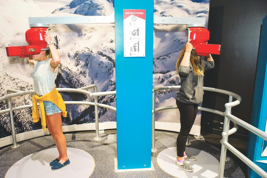 "Children use one of the interactive features at the Denver Museum of Nature & Science's ""Extreme Sports: Beyond Human Limits"" exhibit. It gives visitors a chance to learn about extreme sports and to explore the psychology, physicality and physiology of extreme sport athletes."
