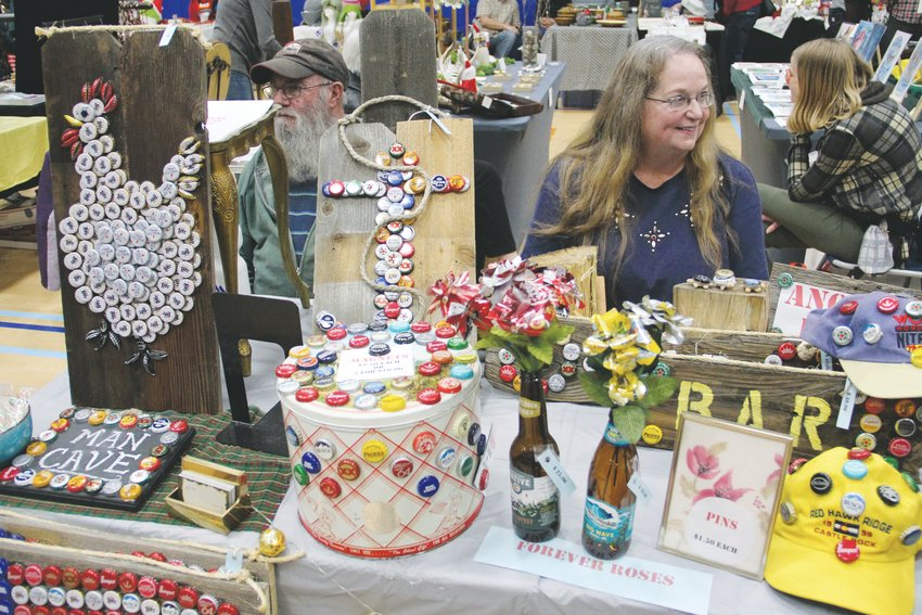Amy Albi, 62, right, and her husband, John Albi, 68, run a table Dec. 7 at the Goodson Recreation Center's annual craft fair. It was the first-ever craft show as a vendor for Amy Albi, a Lone Tree-area resident.
