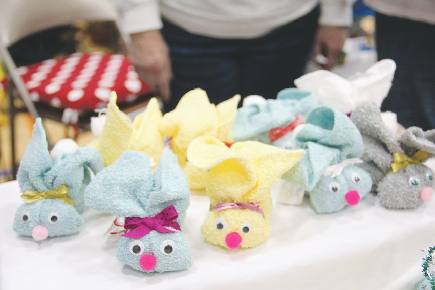"Boo-boo bunnies"" sit at a table at a South Suburban Parks and Recreation craft fair. The crafts, made of washcloths, are shaped so buyers can put ice cubes inside them and apply them to a minor injury without having to hold the ice."