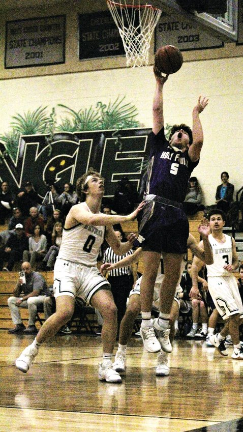 Dec. 5 at D'Evelyn, Holy Family junior Blake Hammond goes up for the shot.