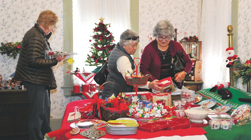 Holiday shoppers left to right, Barbara Johnson, Thornton, Pauline Brito,  and Virginia Herrera, both of Northglenn, peruse gifts on display at this year's Northglenn Old Fashioned Christmas, held at the historic Stonehocker homestead Dec. 7.