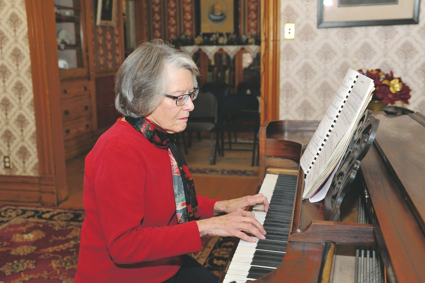 Pianist Nancy Storm of Northglenn plays Christmas carols on an antique Weber piano, during the city's Old Fashioned Christmas open house at the historic Stonehocker Farm, on Saturday, Dec. 7.