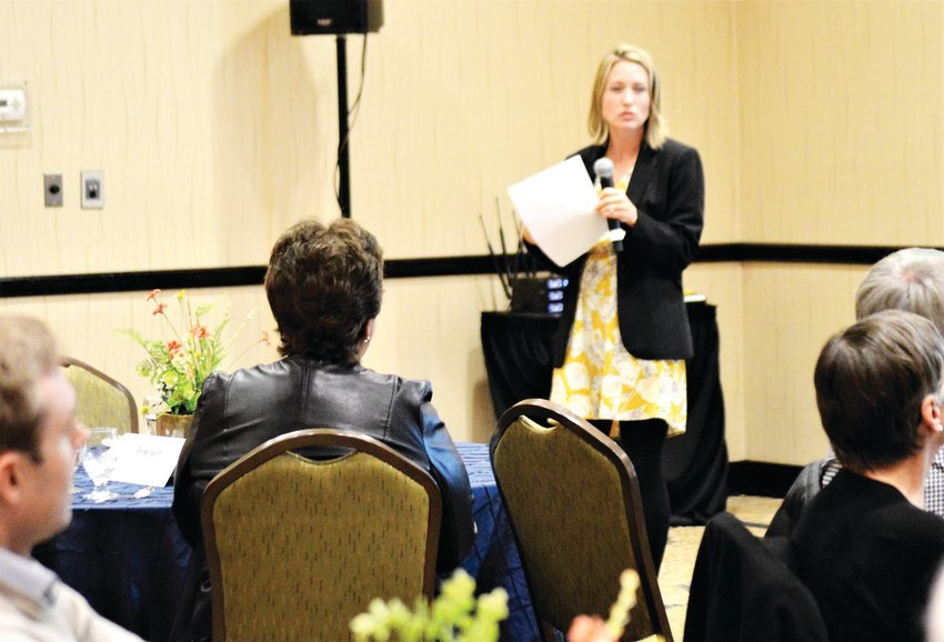 Jessica Ostermick, director of capital markets at Denver's CBRE, discusses Colorado's economy Dec. 4 at a luncheon put on by Adams County Economic Development.