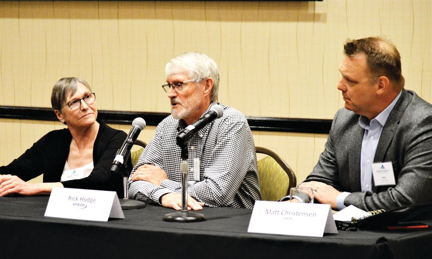 Heating system manufacturer Rick Hodge talks about small business at an Adams County Economic Development luncheon Dec. 4 in Thornton while co-panelists Mary Stevenson, right, and Matt Christensen, left, listen.