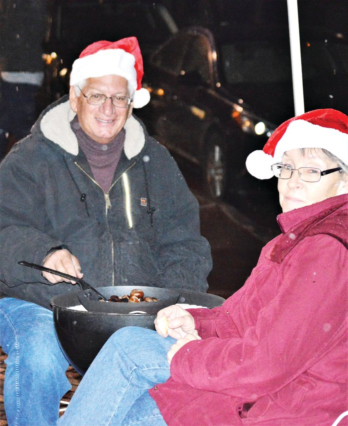 Don and Karen Goodman of Westminster roast chestnuts on a barbecue grill as a part of the Westminster Historical Society's Hometown Christmas celebration Dec. 5 at 73rd and Bradburn.