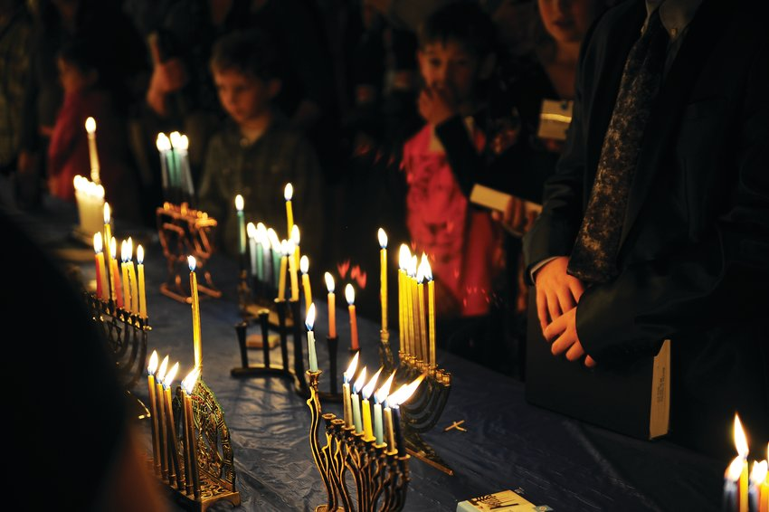 Chanukkah candles burn brightly during Congregation B'Nai Torah's community Hanukkah Service in 2018 in Westminster.