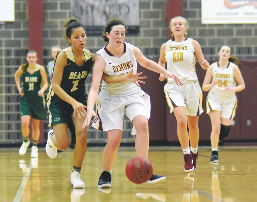 Bear Creek junior Aryanna Cervantes (2) attempts to steal the ball from Golden sophomore Morgan Patterson during the Bears' and Demons' season openers Dec. 3 at Golden High School. The Demons rallied in the second half for a 45-34 victory.