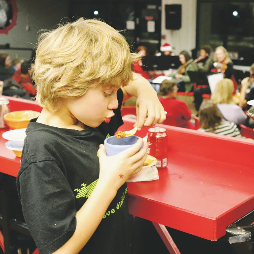 Hackberry Hill fifth-grader Solomon Schoaf eats from his recently purchased bowl during the high school's soup dinner.