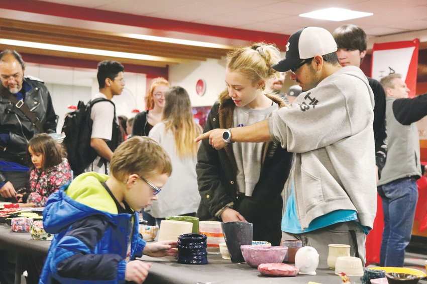 Families shop for ceramic bowls during Empty Bowls at Arvada High.
