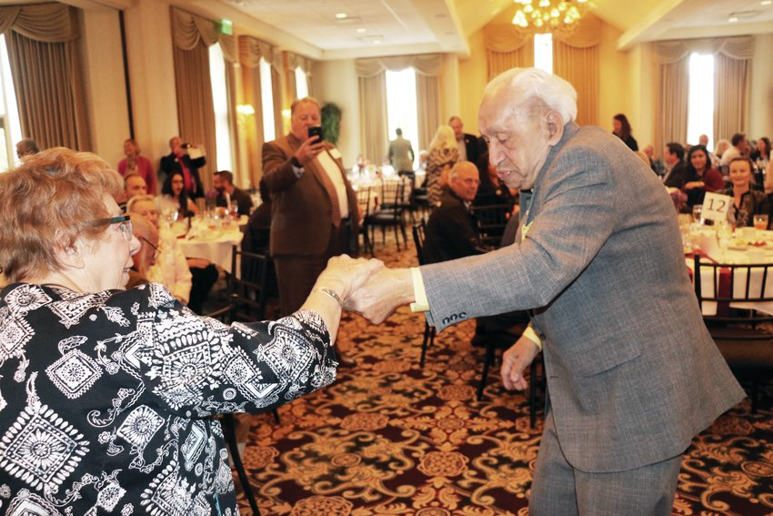 West Colfax Legend Award winners Maddie Nichols and Joe Margotte cut a rug during the corridor's annual luncheon event in 2017.