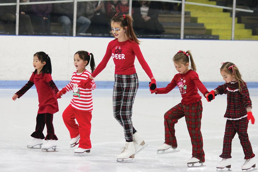 Kids from South Suburban's ice skating programs take a break from lessons to glide with their friends.