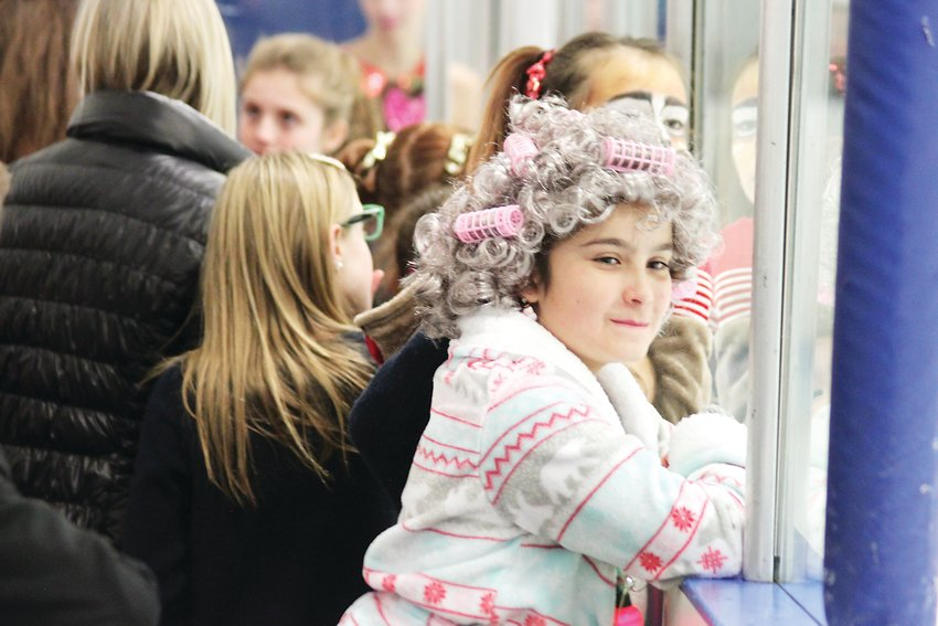"Libby Faulder, who played Grandma in a skating performance to ""Grandma Got Runover By A Reindeer,"" watches from the sidelines."