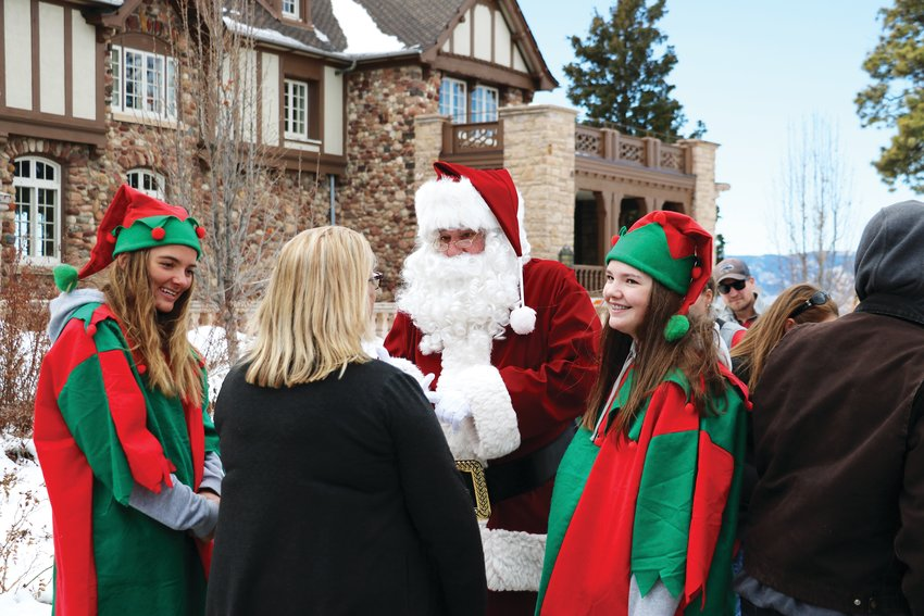 Santa and his elves greet attendees at the Highlands Ranch Mansion holiday event Dec. 7.