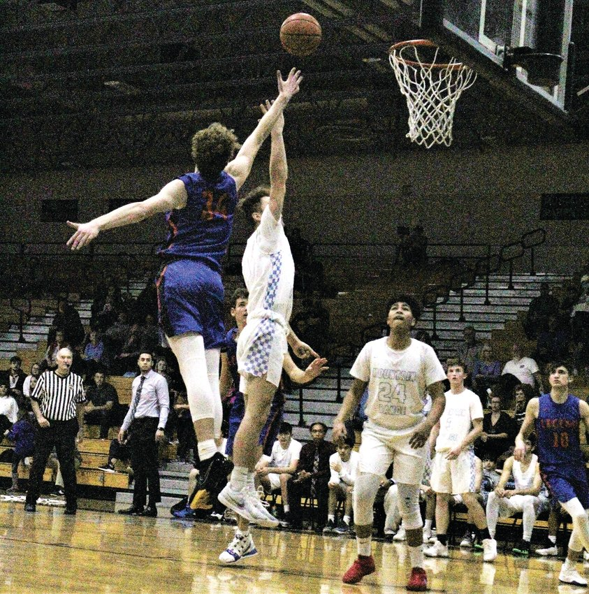Against Legend Dec. 10, Mountain Range junior Truman Chambers hits the floater at home.