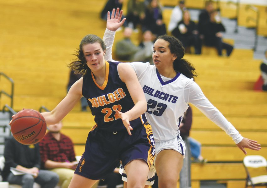 Arvada West senior Calaiya Vickles (23) guards Boulder sophomore Ella Bartsch (22) during the non-league game Dec. 12 at Arvada West High School. The Wildcats held the Panthers to eight field goals to give A-West a 35-30 win.
