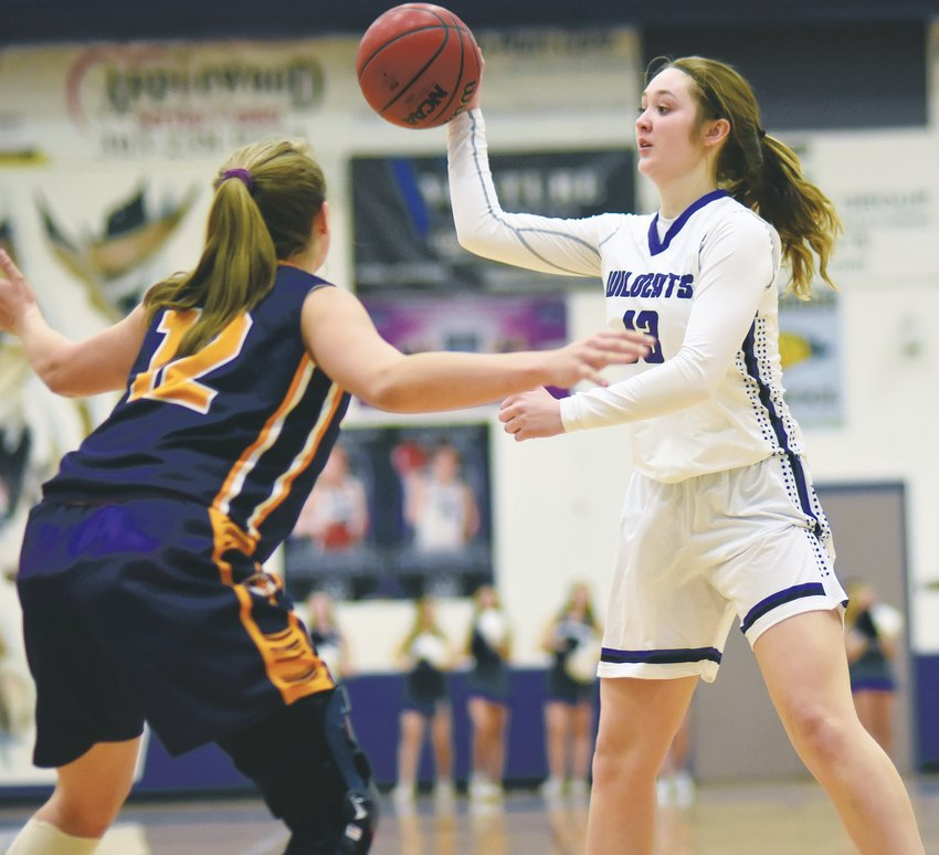 Arvada West sophomore Amanda Neff (13) dumps a pass down low during the Wildcats' 35-30 victory over Boulder on Dec. 12 at Arvada West High School. A-West is off to its best start in five season.