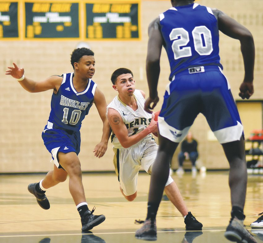 Bear Creek senior Luis Miera (1) attempts to split Hinkley seniors Ja'Vevon Lee (10) and Jeremiah Taylor (20) during the Bears' 61-50 victory over the previously undefeated Thunderbirds Dec. 13 in the semifinals of the Bear Creek Invitational.